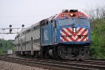 A Westbound Metra Commuter Train Approaching its Station