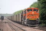 An Eastbound BNSF Coal Train waits for a Westbound CN Freight to Switch Cars