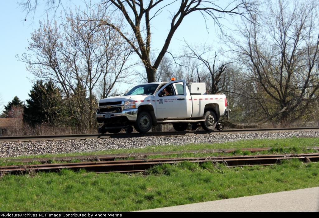 A CP hi-rail truck pauses
