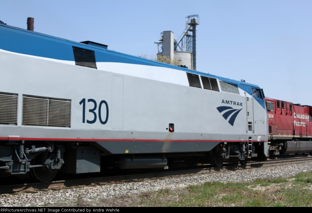 Amtrak #8 meets 283 on the fly just west of town