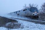 The westbound 'Builder kicks up the fresh snow