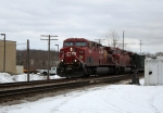 CP 8602 highballs through with a westbound