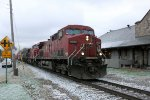 CP 9580 leads a sister elephant style on EB 298 past the depot