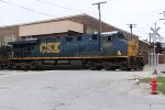 CSX 5281 singlehandedly hauls an eastbound unit grain train across 17th St