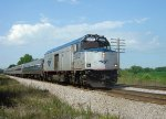 AMTK 90221 breezes south on the front of Hiawatha train 338