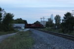 CP 8813 clatters westward across the diamond as dusk sets in