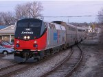 Amtrak's Phase 1 Heritage Unit brings P371 to a stop at the station