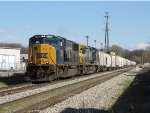 A block of lime cars follow right behind 4546 & 7332 as Q335-04 rolls past Seymour
