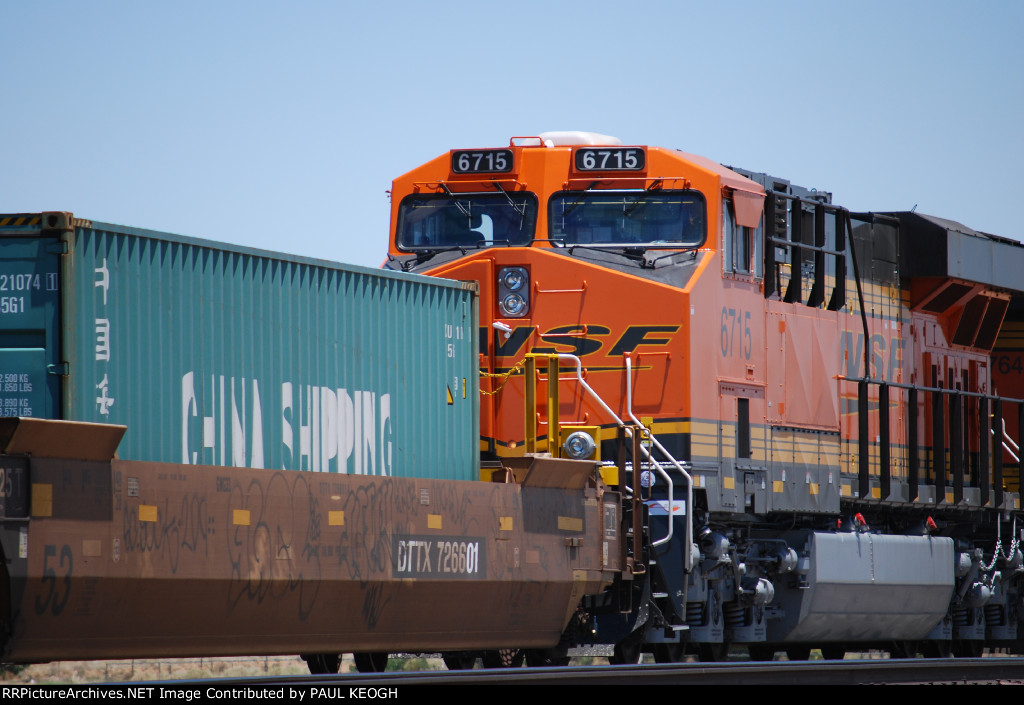 A Very Very Brand New BNSF 6715 heads westbound as a rear DPU on this Hot Z Train.