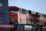 Zoom in shot of the cab of BNSF 6708 and the rear quarter of BNSF 7917 as they head westbound.