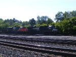 NS 9467 and CN 8940 run elephant style with a mixed freight.