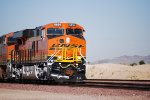 The Rising California Sun Gleems off this Very Brand New BNSF 6894 and her BNSF Swoosh Logo Paint as she slows down to enter the BNSF Barstow Yard.