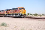 BNSF 6894 as she rolls into the BNSF Barstow yard and the sun reflects off her BNSF Swoosh Logo Paint.