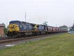 CSX 380 leads a grain train.