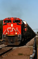 CN 8958 leads a westbound into the setting sun