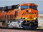 The Setting Sun Glisten's off the Very, Very Brand New BNSF Swoosh Logo Paint of a Hot C4 BNSF 6736 as she pulls westbound out of the BNSF Barstow Yard after a crewchange.