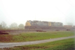 CSX 725 cutting through the fog