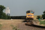 Eastbound coal passing grain elevator