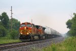 An Eastbound BNSF Stack Train Leaves Town on a Very Wet Morning