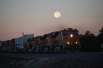 The Setting Full Moon sets on BNSF 7839 at 05:30 am as she heads eastbound with a Z-Train towards Winslow, AZ.