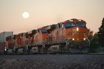 Zoom in shot of the Full Moon setting on BNSF 7839 as she heads east with a Z.