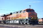 BNSF 6898 MU to BNSF 7590 sits on the North BNSF Needles Siding with BNSF 7402 in the background.