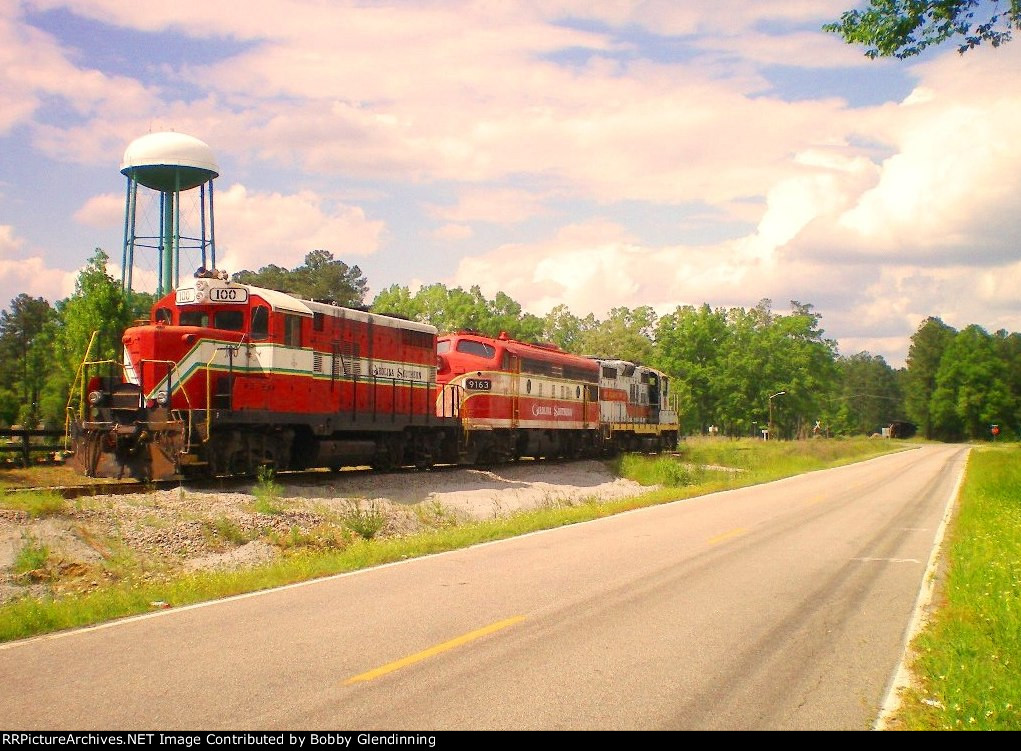Three old CALA locos about ready to couple to a 45-car coal train bound for the powerplant in Conway