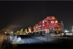 CP 8244 sits idling as NSHR 2004 sneaks up behind note the headlights on track