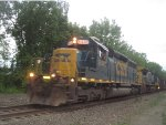 With a wave from the conductor, X434 makes its way by the DD in Orangeburg