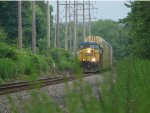 Q268 with a AC4400CW leader by MP27 on the River Line
