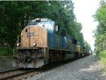 SD70MAC 4739 sits in emergency on the lead of Q409-06