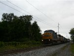 CSX K408 whips by on teh main at CP26