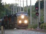 Q410 looks orange as it pulls off the siding!