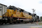 HLCX SD-60 #5964 is crossing Main St. with a westbound coal train