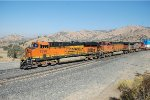BNSF ES-44DC #7398 leads a westbound intermodal into the loop