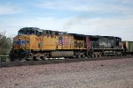UP 5694 + a patched SP AC-4000CW lead a westbound coal train