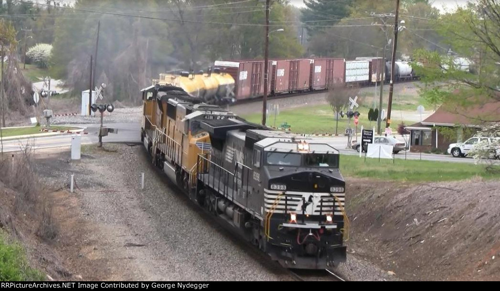 NS 8398 (C40-8W), UP 4281 & 4887 (SD70M) pulling a mixed freight train