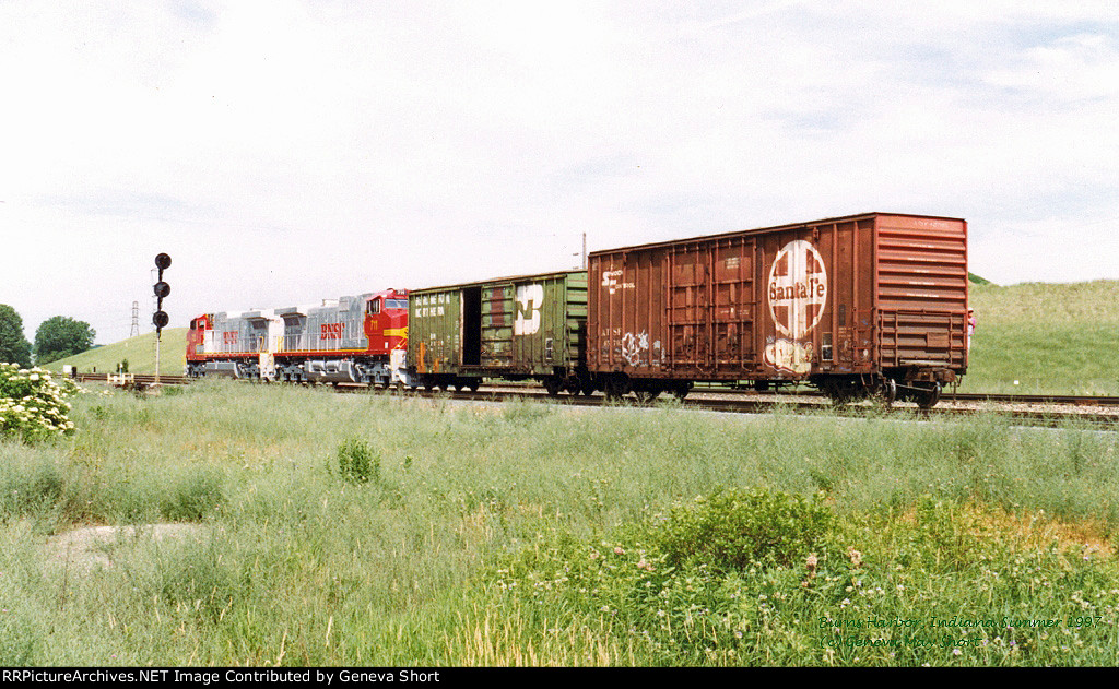 BNSF 712 - BNSF 711 with a BN car and an ATSF car - an accidential reflection of the BNSF merger