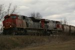CN 8020 & CN 2275 heading west and leading an unusual SSAM Open Hoppers convoy