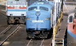 CR E-8 #4022 shares the Race St. engine facility a couple of Amtrak locomotives