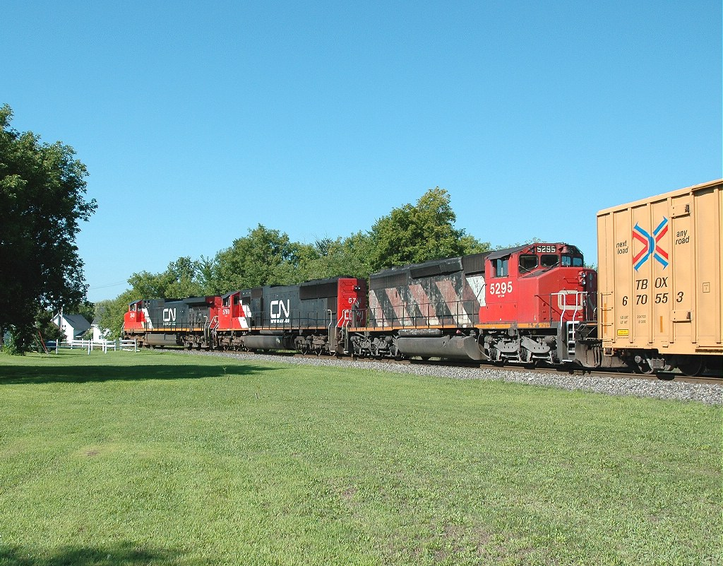 Q623 with all CN power is seen here rounding the 25mph curve in Norwood, NY heading South.
