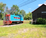 NYOG 14 passes the old Norwood & St. Lawrence Freight House in Norfolk, NY on the Raquette River.