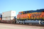 With the Rising Sun's Rays Glistening Off Her Very Brand New BNSF Swoosh Logo BNSF 6743 pushes a Hot Z towards LA.
