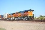 BNSF 6743 and BNSF 6744 Glisten in the Sun's Rays as they proceed west as Rear DPU's at 07:07 am PDT.