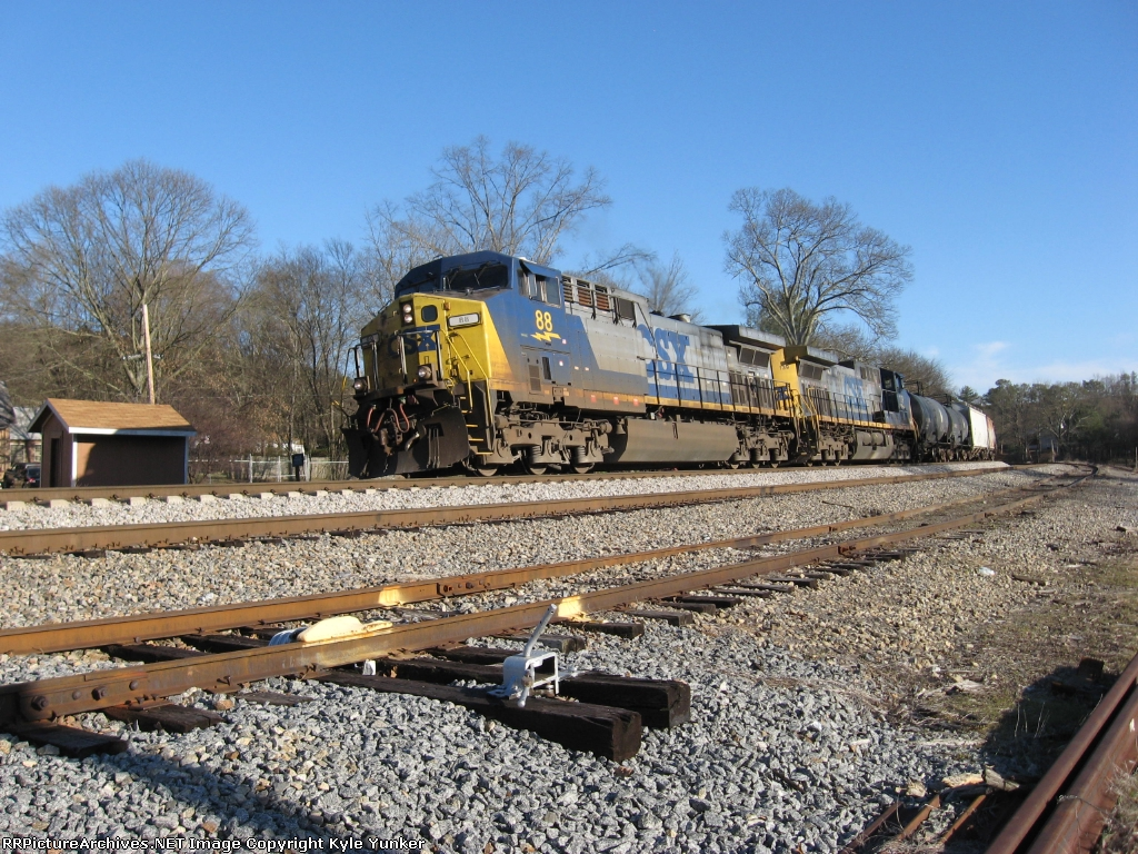 NB freight Q699 on the heels of N105