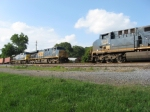 SB intermodal train Q127 meets NB rack train Q228