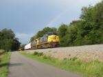 SB freight Q676 cruises by under a rainbow