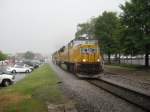NB freight Q580 with a trio of UP SD70Ms roaring through the rain
