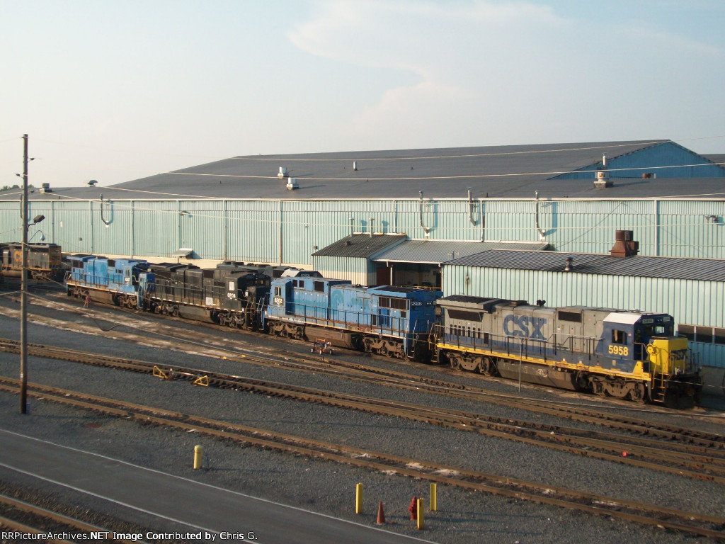 A Line of Ex. Conrails and One Ex. Penn Central With A CSX B40-8