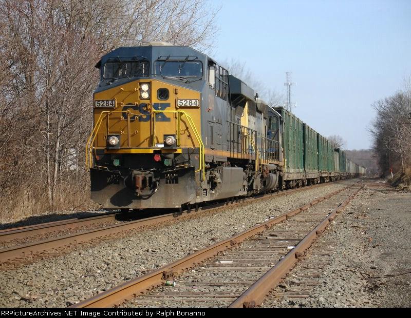 CSX Train K207, unit trash train, heads through town for the Trenton Line
